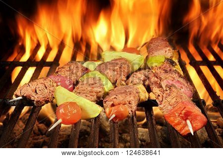 Four Roasted Beef Kebabs With Vegetables On Bbq Flaming Grill