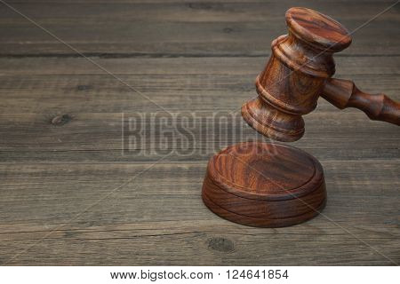 Real Judges Or Auctioneer Gavel On The Black Wooden Table