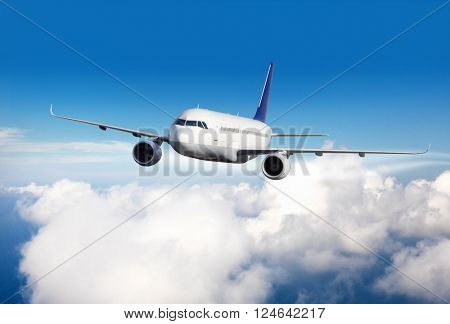 Commercial jet plane flying above clouds