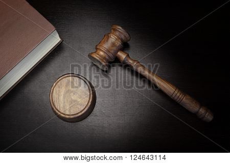 Top View Of Judges Gavel Red Law Book On The Black Wood Background Conceptual Image