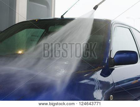 Car wash using high pressure water jet.