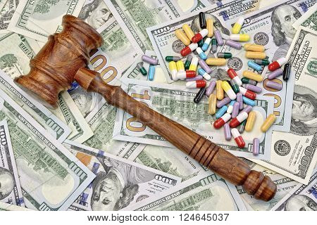 Judges Gavel And Drugs On The Dollar Cash Background
