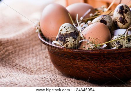 Pile Of Fresh Hen And Quail's Eggs In A Brown Bowl