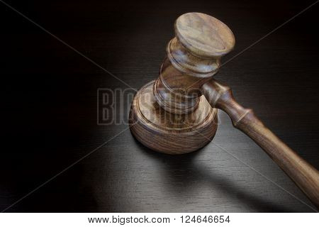 Judges Or Auctioneer Gavel On Black Wood Grunge Background
