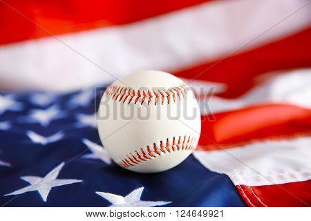 Baseball on background of American flag. Popular sport concept