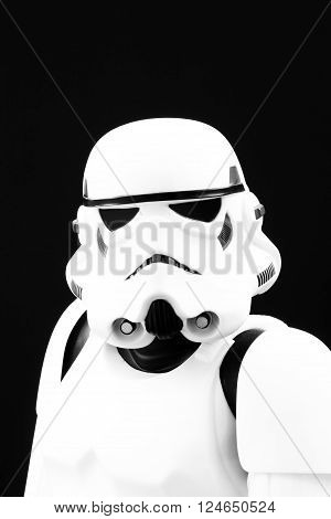 YORK, UK - JANUARY 24, 2016. A head and shoulders portrait of a Star  Wars Stormtrooper from The Force Awakens movie on a black background.