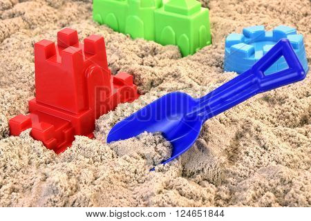 Colored Plastic Shovel And Mold In  Sand On The Beach