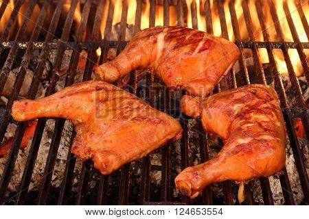 Three Chicken Leg Quarter Roasted On Hot Bbq Flaming Grill