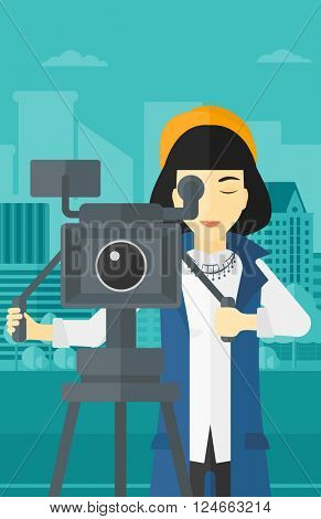 Camerawoman with movie camera on a tripod.