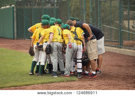 Baseball team in a huddle