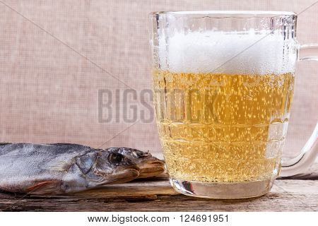 beer glass and dry fish close up