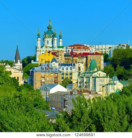 Kiev Ukraine. Beautiful view of the St. Andrew's Church on the Andrew's Descent among green trees of the Castle Hill in Kyiv