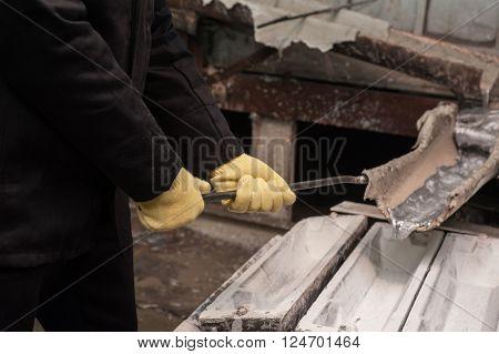 Industrial worker in metal melting factory