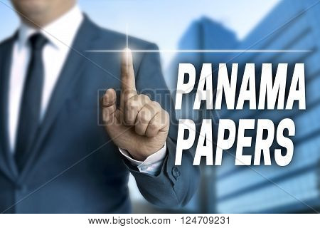 Panama papers touchscreen is operated by businessman.