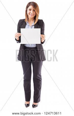 Pretty Businesswoman Holding Up A Sign
