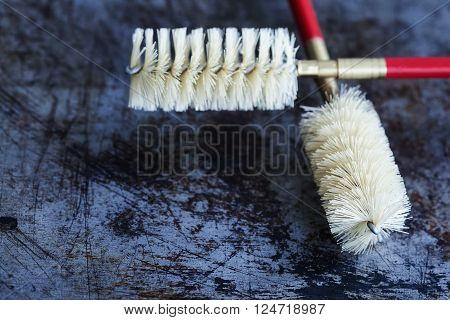 Cleaning brushes, aged shabby scratch textured background. vintage brush with plastic bristle