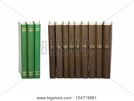 Vintage green books and brown books with serial numbers on covers. White background, isolated