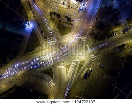 Thessaloniki Greece - January 11 2016: Aerial view of cross road in Thessaloniki at night Greece. Image taken with action drone camera causing distortion and blur.