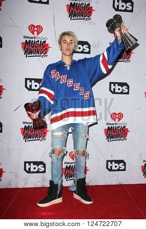 LOS ANGELES - APR 3:  Justin Bieber at the iHeart Radio Music Awards 2016 Press Room at the The Forum on April 3, 2016 in Inglewood, CA
