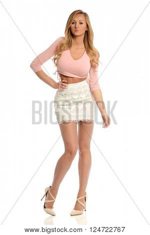 Young Woman with skirt and high heels isolated on a white background
