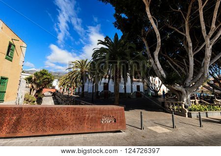 Summer cityscape on tropical island Tenerife Canary in Spain. Street of old town Guia de Isora.