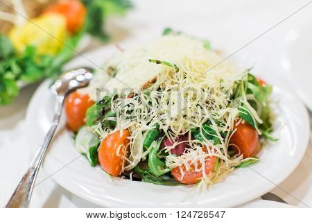 Salad. Table full of food at a restaurant.