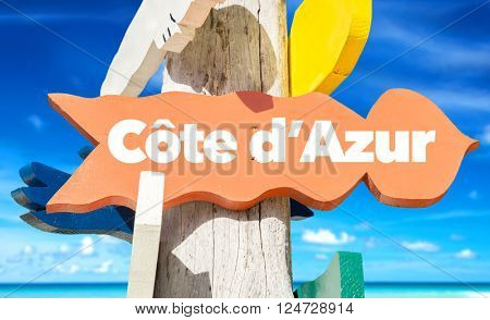 Cote d'Azur signpost with beach background