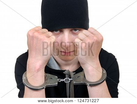 Serious Young Man in Handcuffs Isolated on the White Background