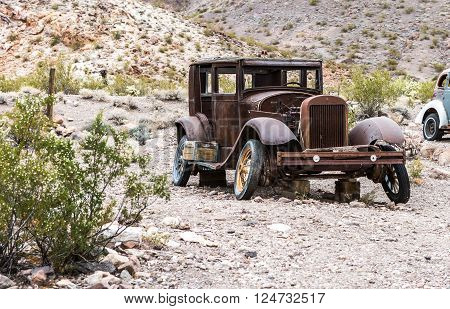 NELSON USA - JUNE 10 : Rusty old vintage car abandoned in Nelson Nevada ghost town on June 10 2015