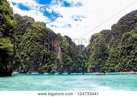 PHUKET, THAILAND - AUGUST 18, 2014: Tourist boats at Phi Phi island in Thailand. Phi Phi islands is one of Thailand's most famous destinations.