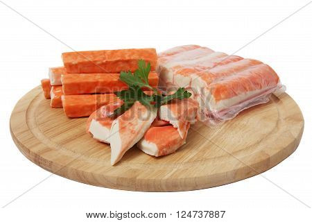 Imitation crab meat on wooden board isolated on white background