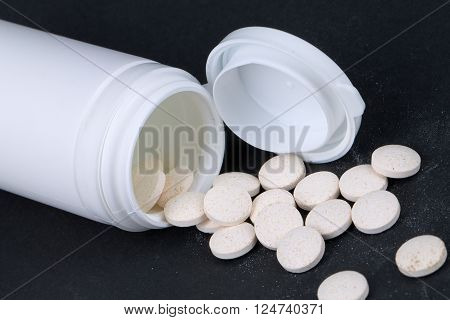 Jar with the pills falling out of it