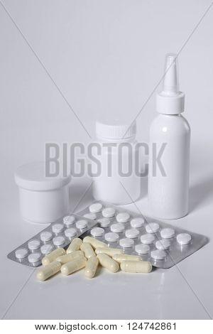 Medicines. Medicine bottles, spray, pills and capsules