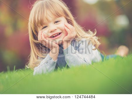 Beautiful young girl having fun in the park