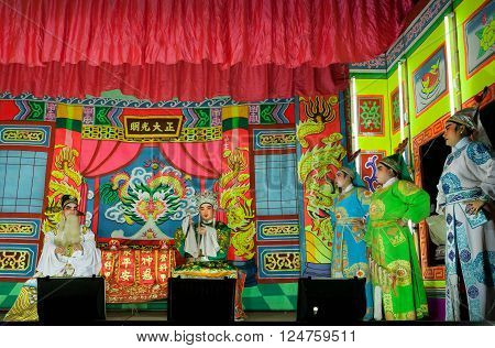 LAMPANG, THAILAND - FEB 18: Chinese theater play with actors in tradional costums on colorfull stage on February 18, 2016. Population of Lampang is near 59000 people