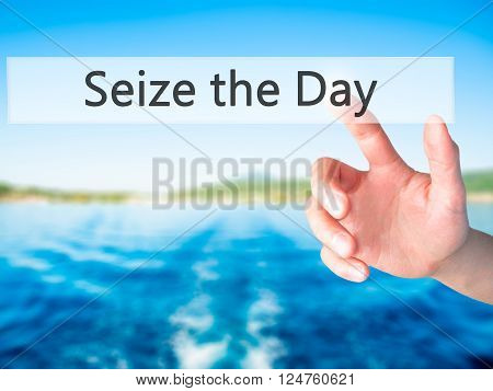 Seize The Day - Hand Pressing A Button On Blurred Background Concept On Visual Screen.