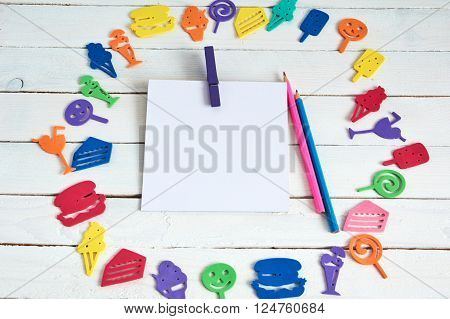 Color Toys on wooden background and fanny cartoon food