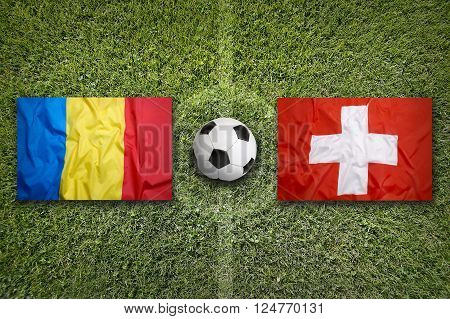 Romania vs. Switzerland flags on green soccer field, Group A