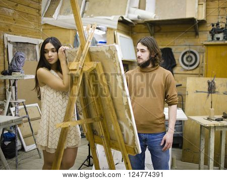 painter at work with model muse in studio waiting inspiration, lifestyle people concept