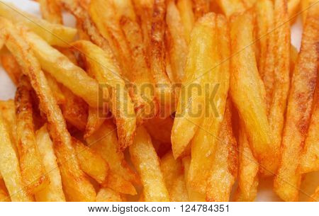 Heap of french fries fried in oil, deep fried, unhealthy and caloric food