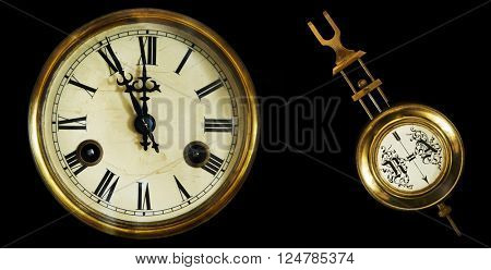 collection of old clocks and pendulum. The end of the 19th century. Isolated on a black background