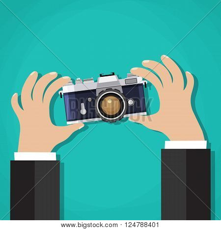Flat illustration of Retro  photo camera with hand holding it. Vector illustration of a hand holding Vintage  camera for your design