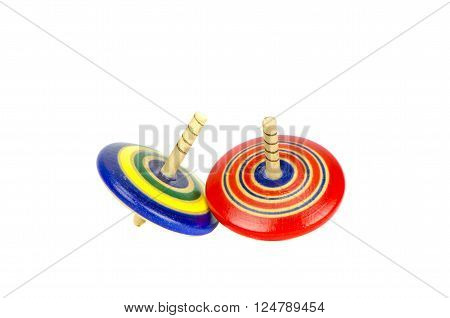 two beautiful colorful woooden whirligig isolated on white