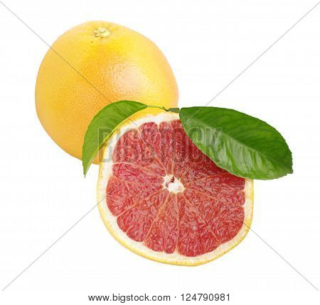 half and whole grapefruits with green leaves on white isolated