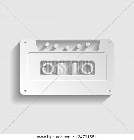 Cassette icon, audio tape sign. Paper style icon with shadow on gray.