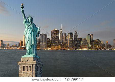 Manhattah skyline at night and Statue of Liberty.