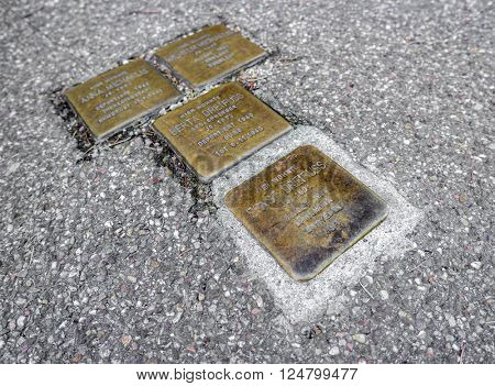 BADEN-BADEN, GERMANY  - FEBRUARY 27, 2016  Stolperstein (Stumbling Block), a sculpture and monument created by Gunter Demling. Cobblestone-sized memorials on the pavements.