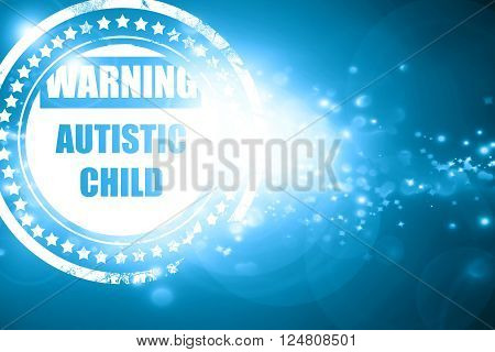 Glittering blue stamp: Autistic child sign with orange and black colors