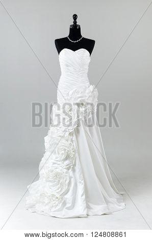 Modern White Wedding Dress Isolated On Grey Background