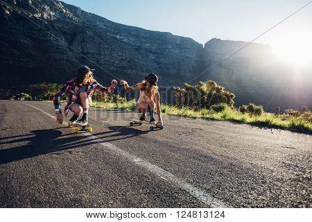 Best Friends Having Fun With Skateboard